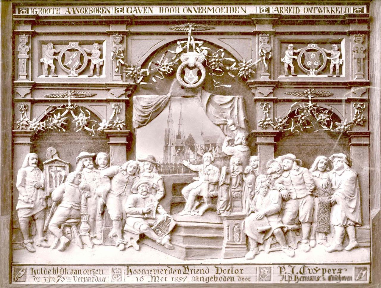 Foto van een plaquette symboliserend een huldeblijk voor Dr. P.J.H. Cuypers