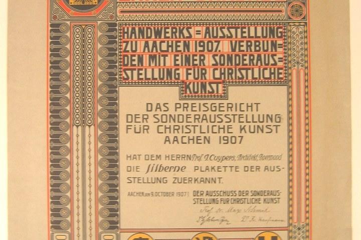 Oorkonde voor zilveren plakette tijdens Handwerks Ausstellung in Aken